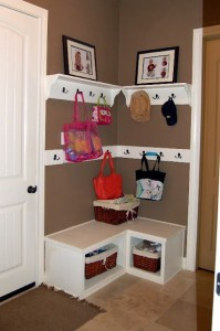 Hang canvas bags from hooks