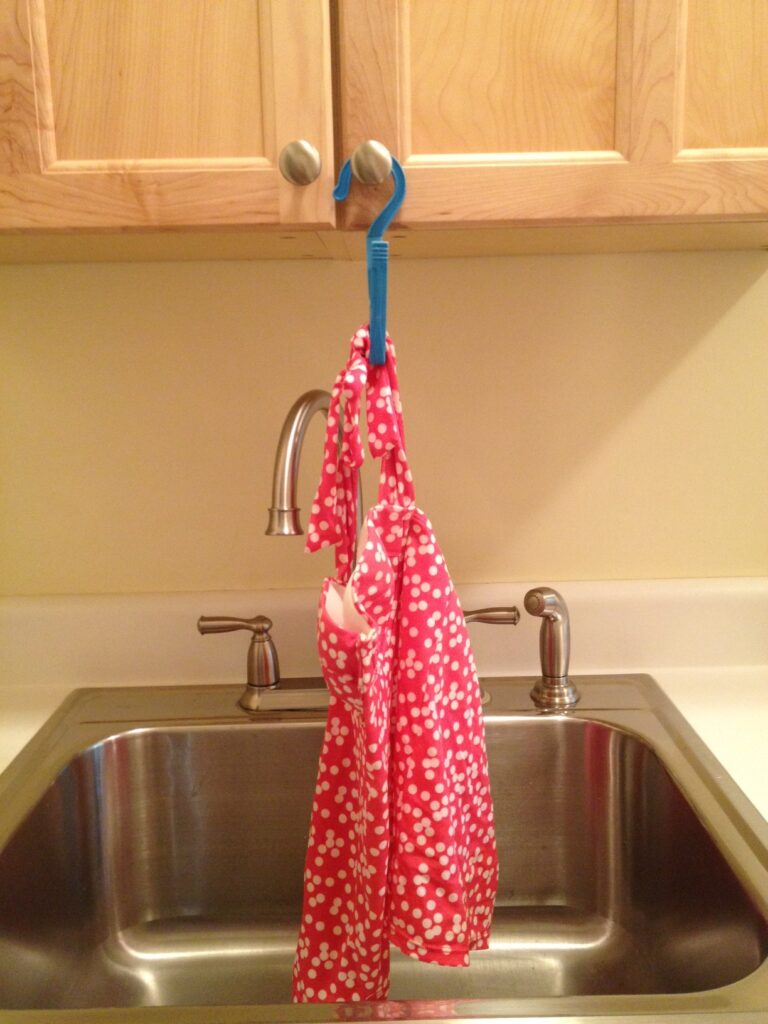 Hang a wet bathing suit over a sink
