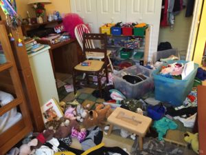 Floor covered with clutter. When stuff ends up on the floor.