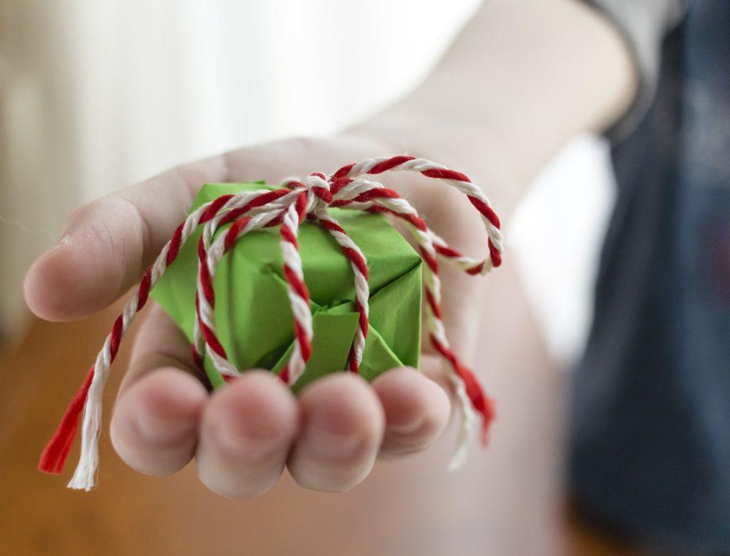 hand giving a christmas gift