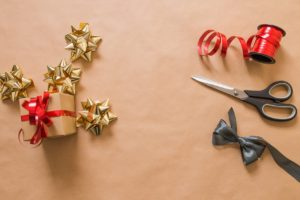 """Wrapping gifts. If you are staring at a pile of unwrapped gifts and dreading the next few weeks, here are some suggestions to """"get your jolly back."""""""