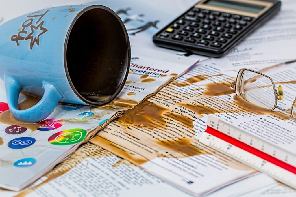Spilled mug on work papers