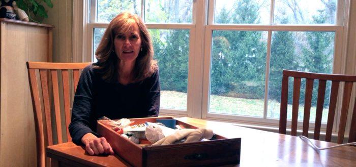 woman organizing a drawer