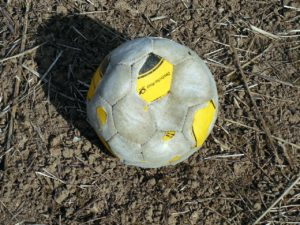 Old, beat-up ball
