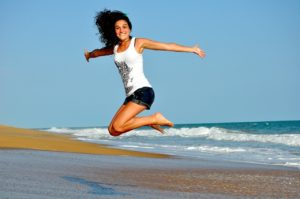 woman jumping in the air and smiling
