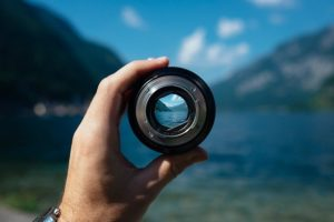 looking through a camera lens and seeing the distance in sharp focus