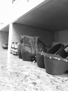 Shoes lined up in a mudroom