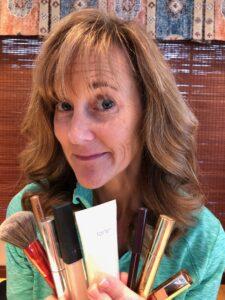 Seana holding makeup