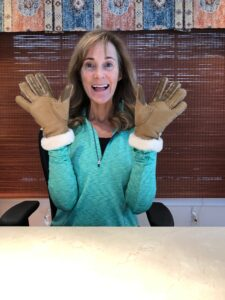 Seana wearing gloves to talk about clearing out your car's glove compartment.
