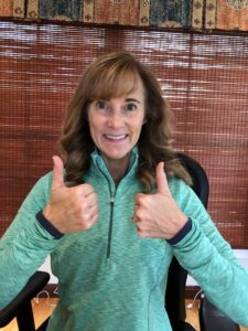 Seana with thumbs up. Select an affirmation on which to focus throughout the year.