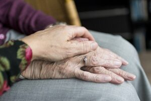 Younger hand on older person's hands. Are you concerned about your aging parents and uncertain how to help them?