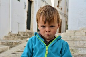 frowning boy. situations or events which we don't care for.