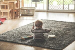 Child playing with musical instruments. children and organizing